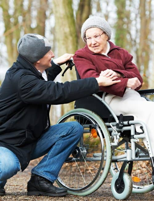 Disabilities Care - Care Assistant with Lady in Wheelchair